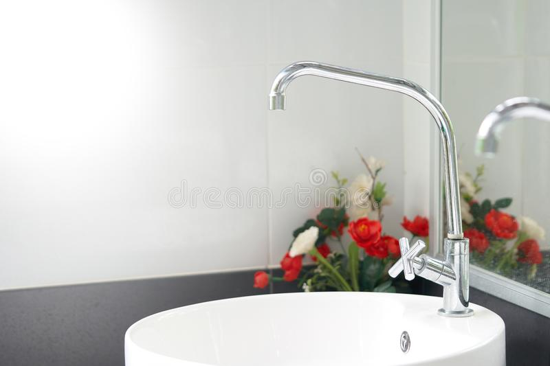Modern white sinks provide a clean feel. Germs and dirt the bath royalty free stock image