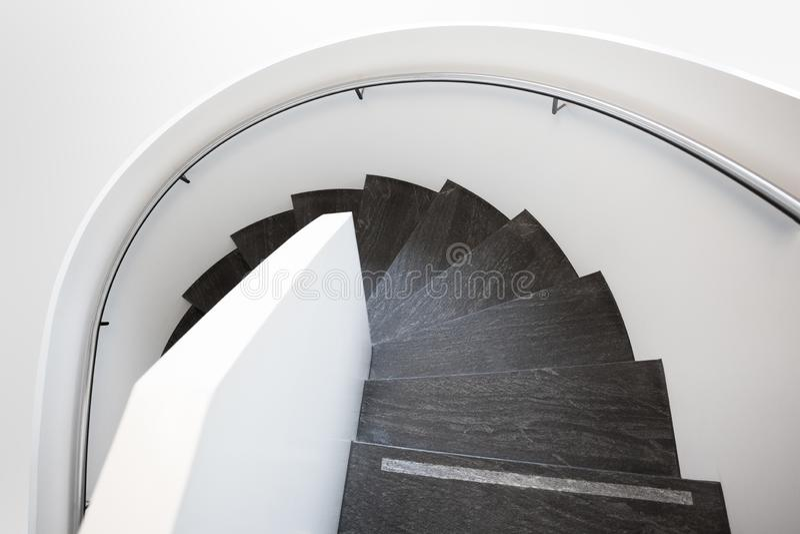 Modern white spiral staircase stock image