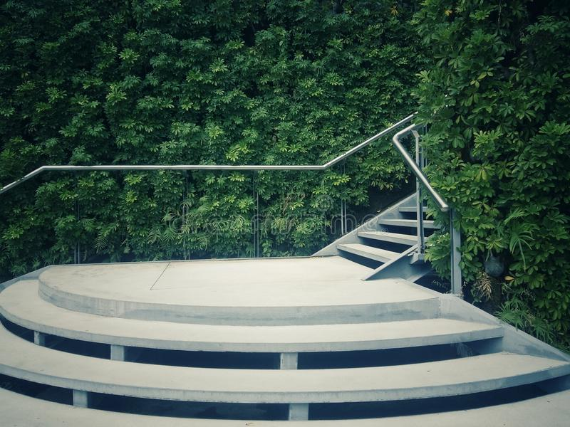 Modern white stairs with natural walls. With green plants or trees growing royalty free stock images
