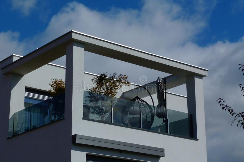 Modern white terrace balcony with patio furniture and blue sky royalty free stock photography