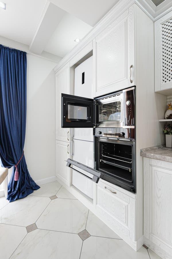 Modern white wooden kitchen interior stock images