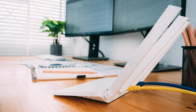 Modern Wi-Fi router on light table in home office.  stock photography