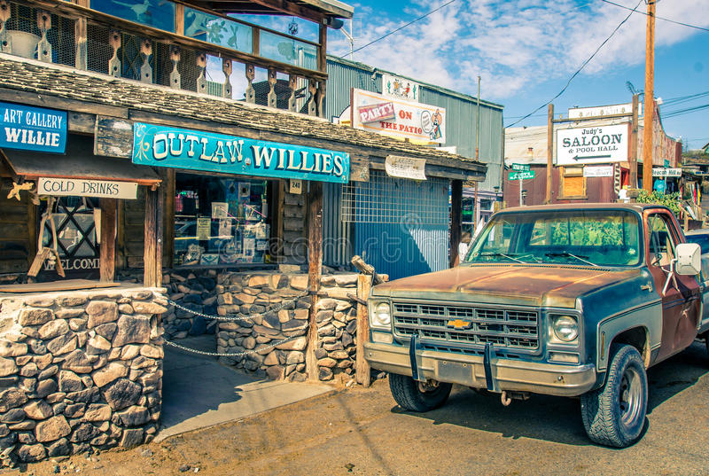 Modern Wild West scenery with tourist shops and old rusty pickup car in Oatman. stock images