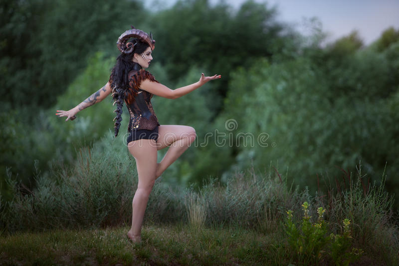 Modern wild woman with horns. stock image
