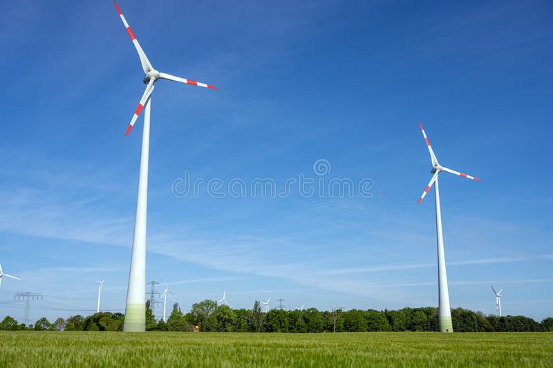 Modern wind turbines with a clear blue sky royalty free stock photos