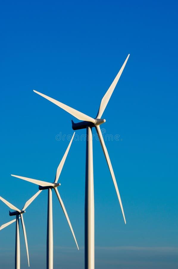 Modern wind turbines or mills providing energy stock photography