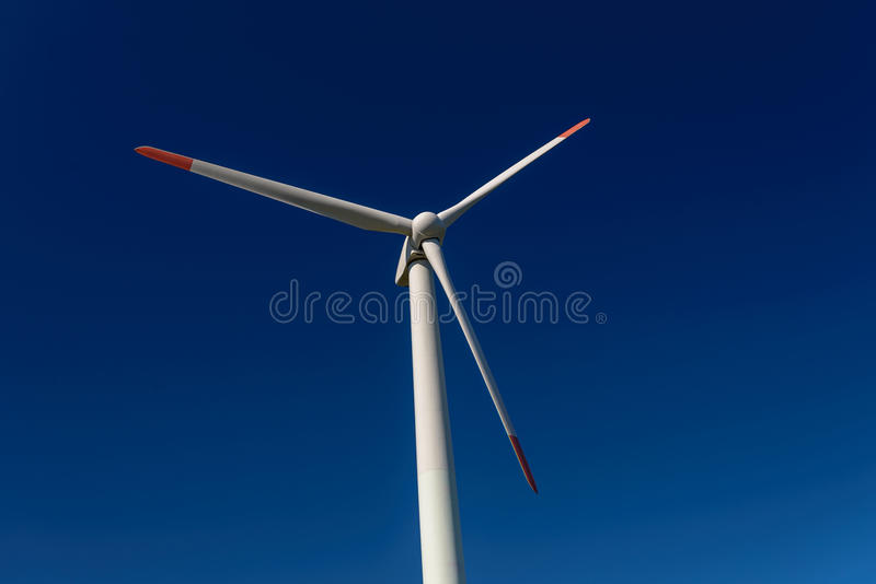 Modern Windmill Turbine on intense blue sky stock photo