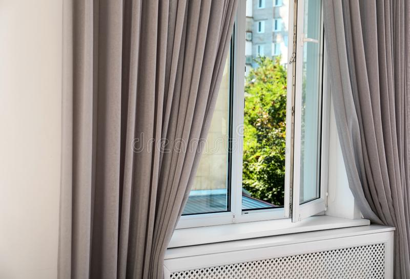 Modern window with curtains in room. Home interior royalty free stock photos
