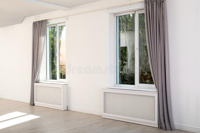 Modern windows with curtains in room stock photo