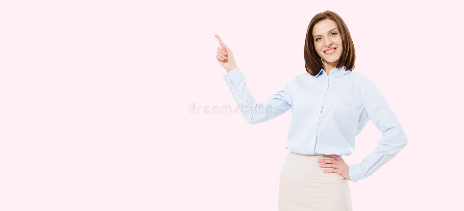 Modern woman pointed on pink background,copy space royalty free stock photography