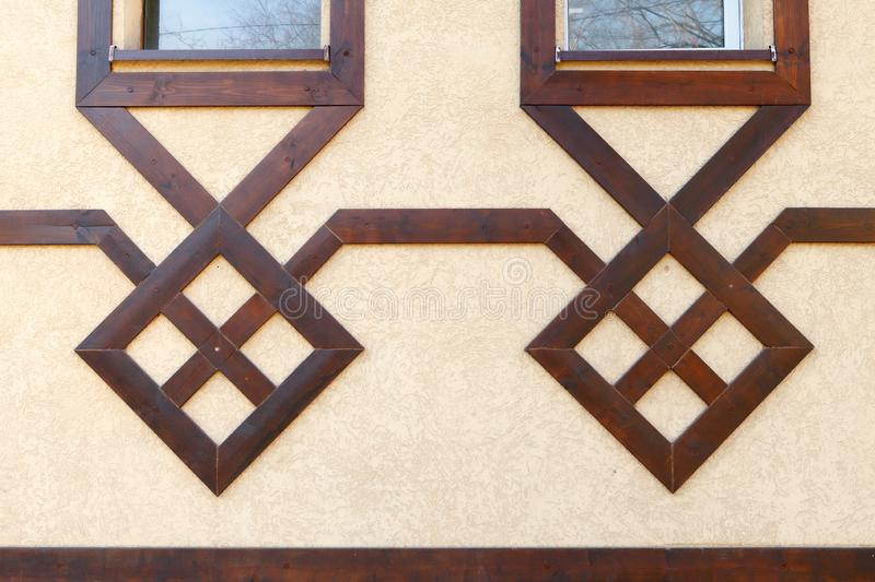 Modern wooden design of the facade of the building. Pseudo half-timbered houses royalty free stock images