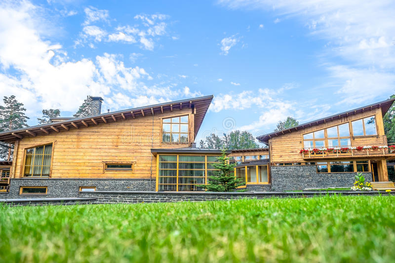 Modern wooden eco-house stock images