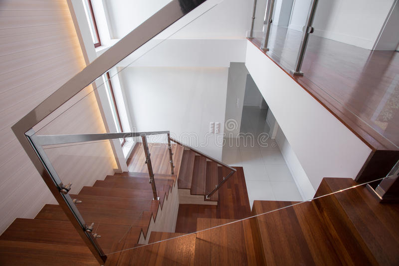 Modern wooden and glass staircase. Modern stylish wooden and glass staircase in minimalistic design stock photo