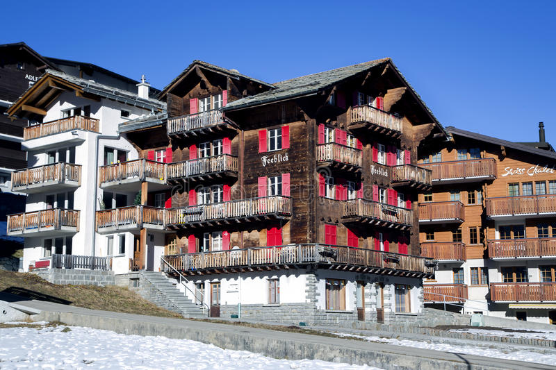 Modern wooden hotels in the charming Swiss resort of Saas-Fee. SWITZERLAND, SAAS-FEE, DECEMBER, 26, 2015 - Modern wooden hotels on a bright sunny day in the royalty free stock photography