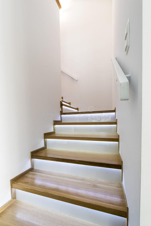 Modern wooden staircase. With glass finishing stock images