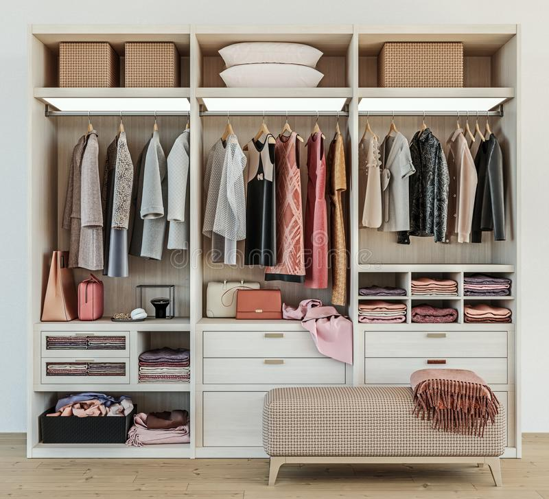 Modern wooden wardrobe with clothes hanging on rail in walk in closet design interior stock photography