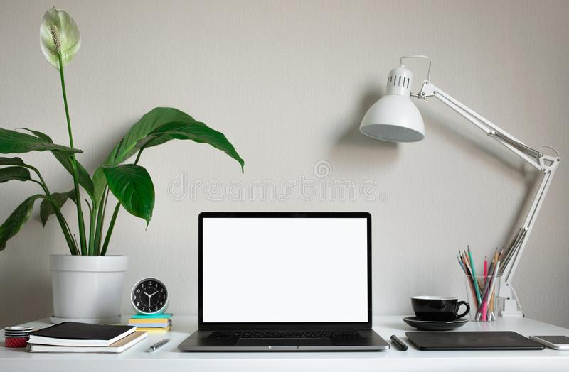 Modern work table with blank computer laptop and accessories in home office studio.Freelance designer or blogger concepts ideas stock image