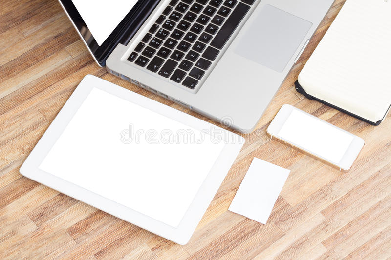 Modern working place. With empty c tablet, phone and notebook royalty free stock photography