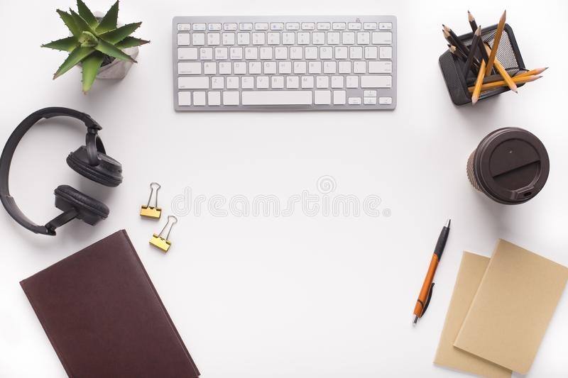 Modern Workplace with office stationery on white background. Copy space for advertisement stock photos