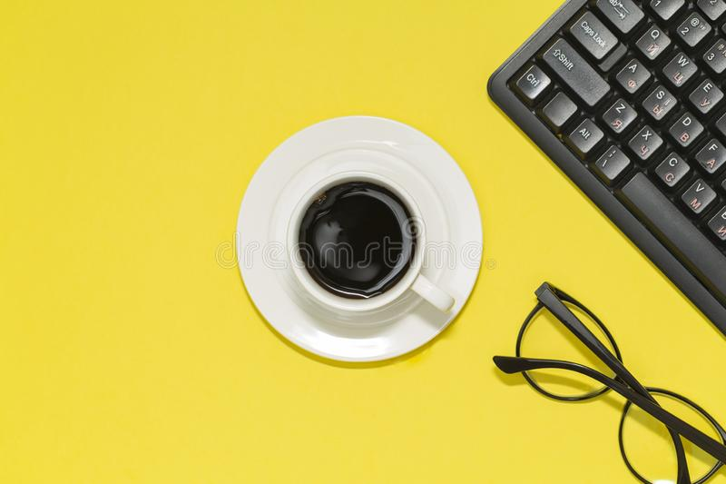 Modern workspace with laptop, coffee cup and eyeglasses copy space on color background. Top view. royalty free stock image