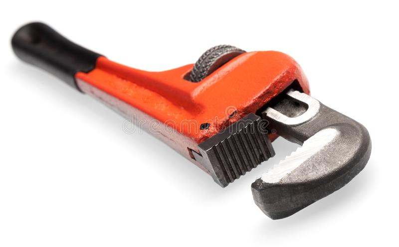 Modern Adjustable wrench on background stock photography