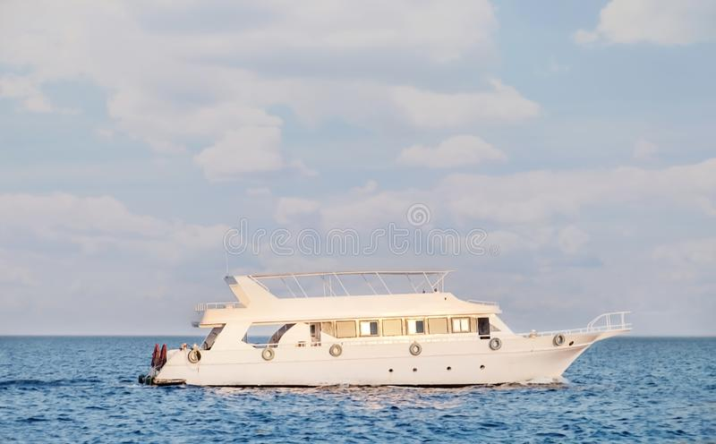 Modern yacht in the sea on tropical resort royalty free stock photos