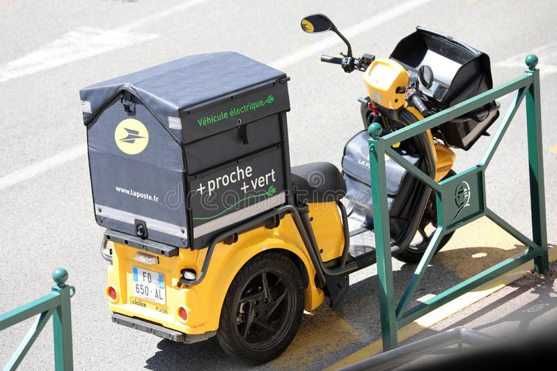 Modern Yellow Postal Delivery Staby Electric Scooter In France stock images