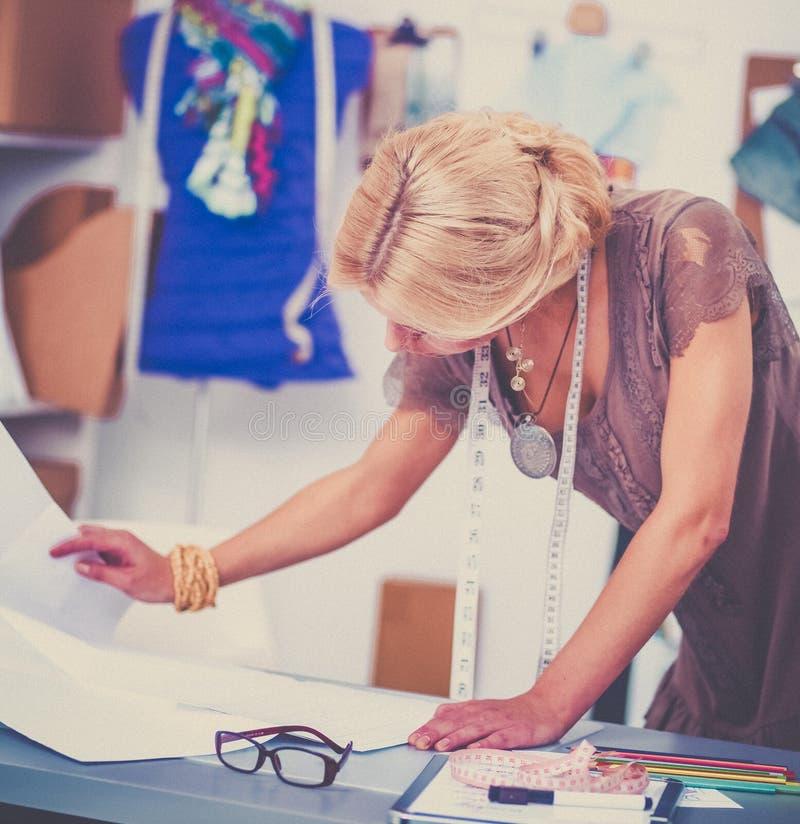 Young fashion designer working at studio. royalty free stock photo