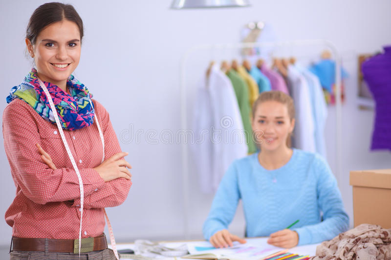 Modern young fashion designers working at studio. stock photography