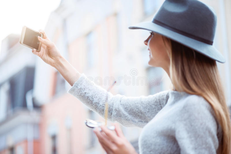 Modern young woman in a big city royalty free stock photos