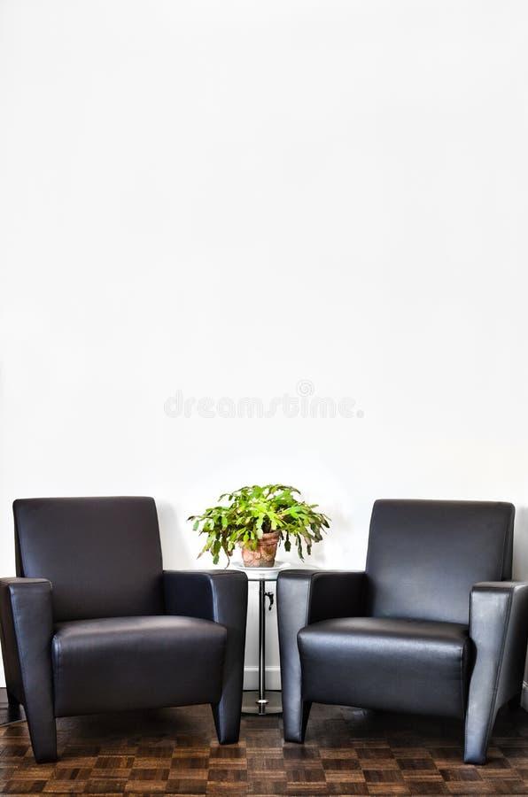 Moderne Binnenlandse Zaal en witte muur stock afbeeldingen