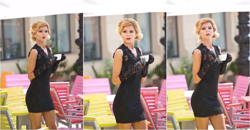 Moderne Dame mit kurzem schwarzem Spitzekleid und roter Schal und hohe Absätze, Außenaufnahme Junge attraktive kurzhaarige Blondi lizenzfreie stockfotos