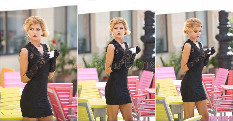 Moderne Dame mit kurzem schwarzem Spitzekleid und roter Schal und hohe Absätze, Außenaufnahme Junge attraktive kurzhaarige Blondi stockbild