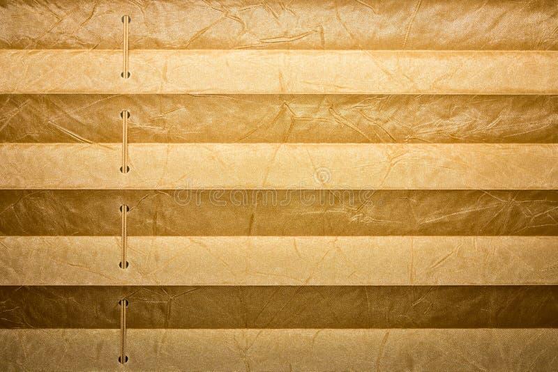 Moderne en bruine geplooide zonneblinden, textuur met schaduwen royalty-vrije stock foto's