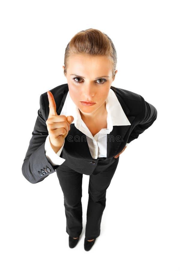 Moderne Geschäftsfrau, die ihren Finger rüttelt lizenzfreie stockfotos