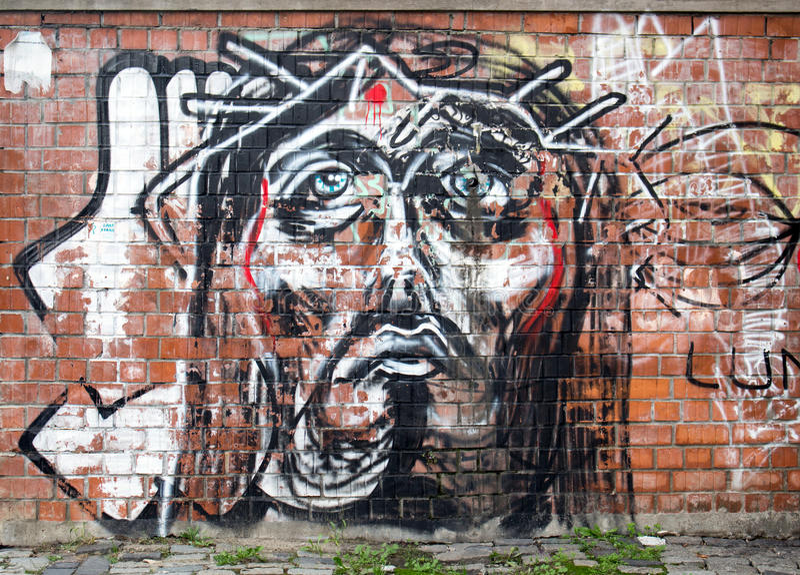 Moderne het schilderen graffiti op een muur in Boekarest die Jesus Christ-gezicht vertegenwoordigen stock illustratie