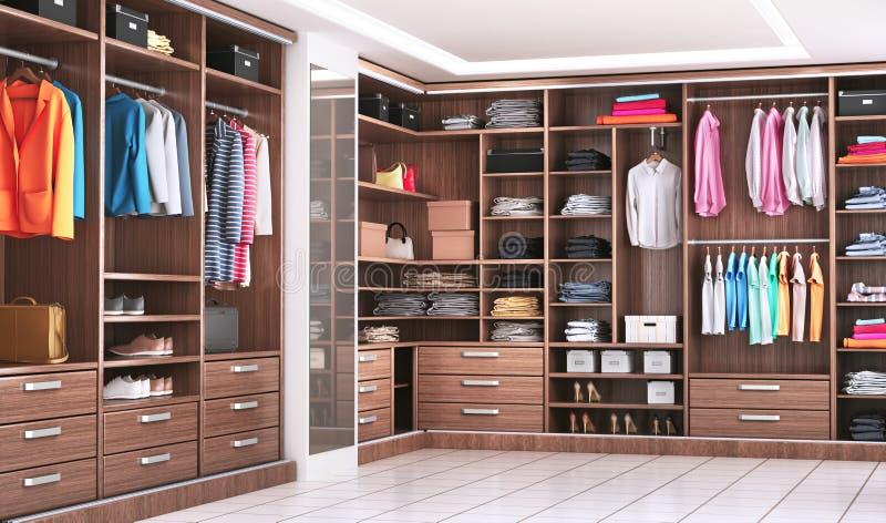 Moderne houten garderobe met kleren die op spoor in gang in het binnenland van het kastontwerp hangen royalty-vrije stock afbeelding