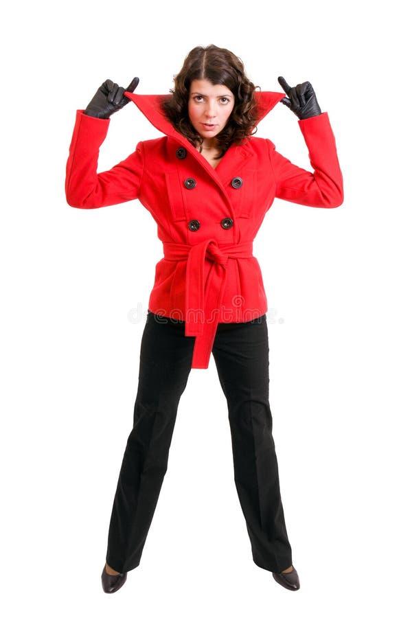 Moderne junge Dame mit ihren Händen oben lizenzfreie stockfotografie