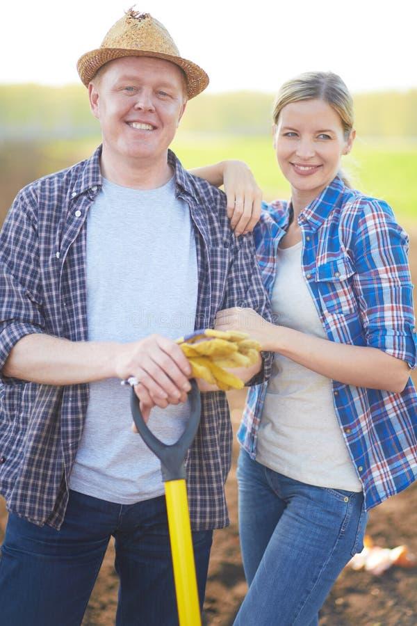 Moderne landbouwers stock afbeeldingen