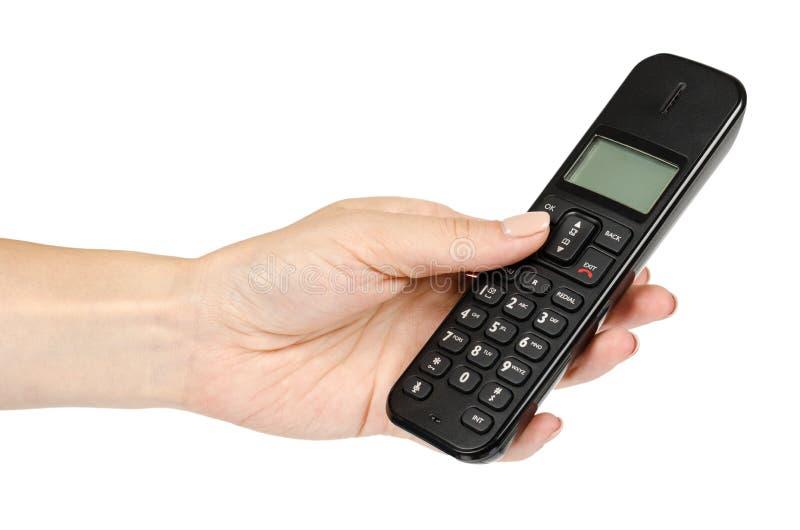 moderne landline draadloze telefoon met hand, oud technologieconcept royalty-vrije stock afbeeldingen