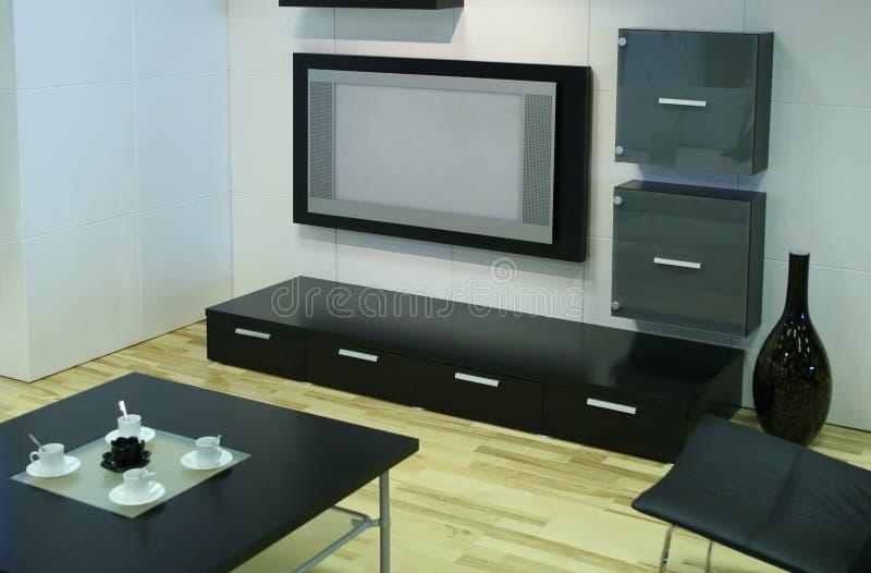 Moderne ruimte met TV stock afbeeldingen