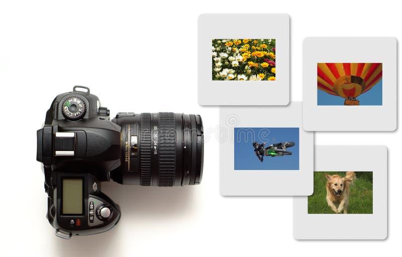 Moderne slrcamera die met kleurendia's wordt geïsoleerdl stock afbeelding