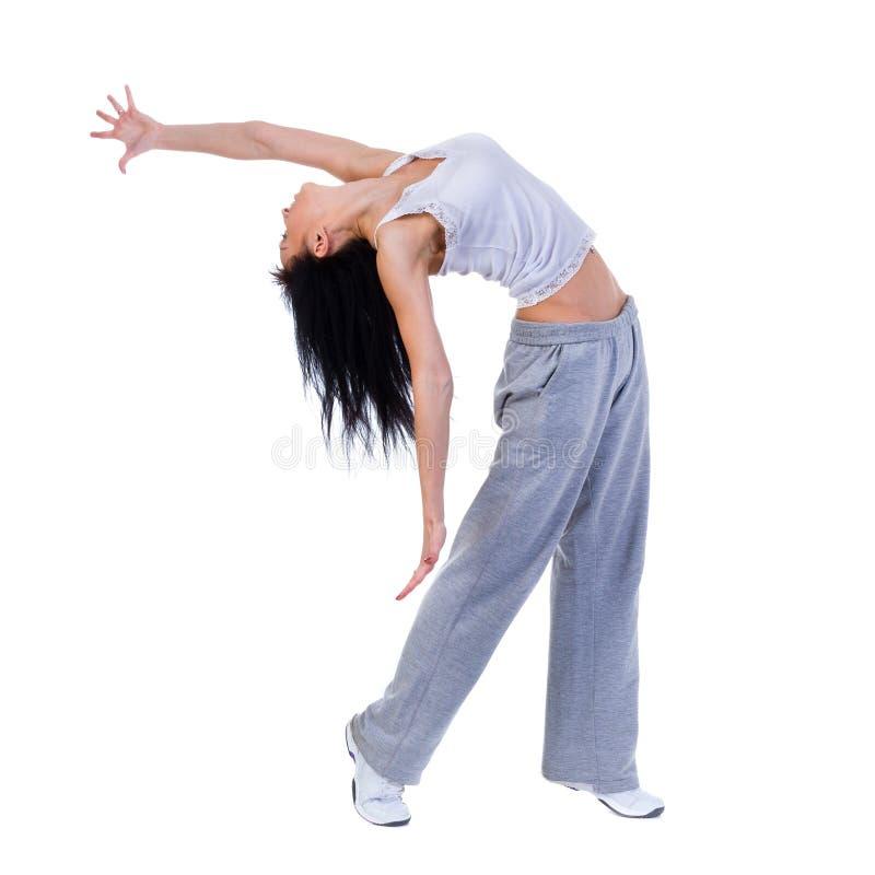 Moderne stijldanser die sommige bewegingen tegen geïsoleerde witte achtergrond tonen royalty-vrije stock fotografie
