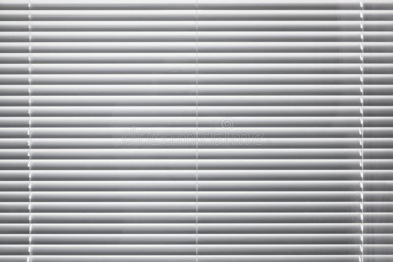 Moderne weiße Jalousiehintergrundbeschaffenheit stockfotografie