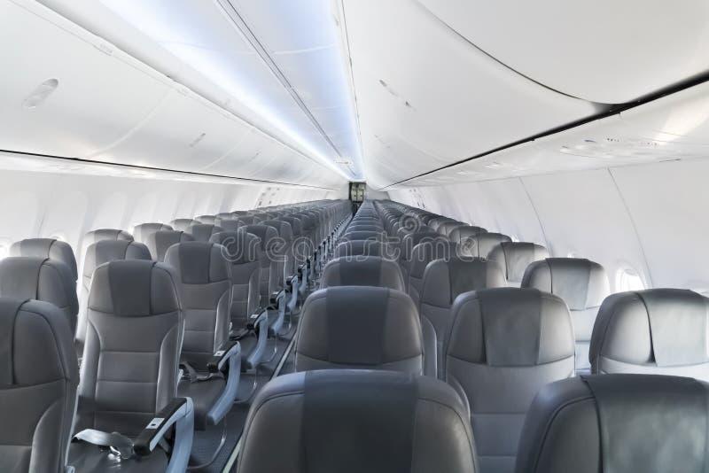 Moderner Innenraum des Passagierflugzeugs stockbilder