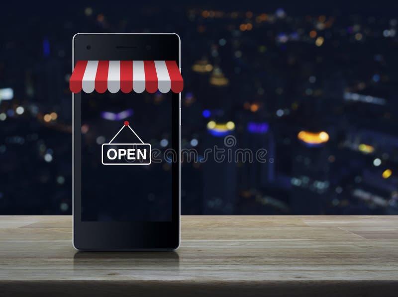 Moderner intelligenter Handy mit auf Linie Einkaufsspeichergraphik lizenzfreie stockfotografie