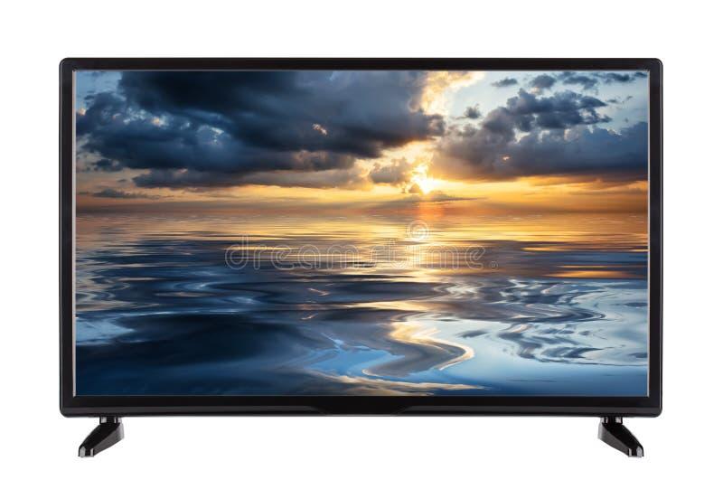 Modernes Flachbildschirm Fernsehen mit Sonnenunterganghimmel auf Schirm lizenzfreie stockbilder