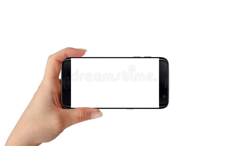 Modernes lokalisiertes schwarzes intelligentes Telefon in der Frauenhand in Waagerechte stockfotografie
