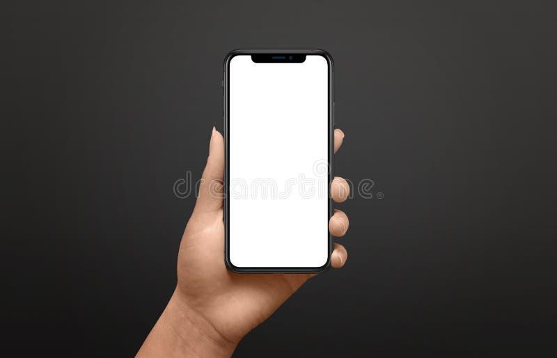 Modernes Telefonmodell in der Frauenhand Schwarzer Hintergrund lizenzfreie stockbilder