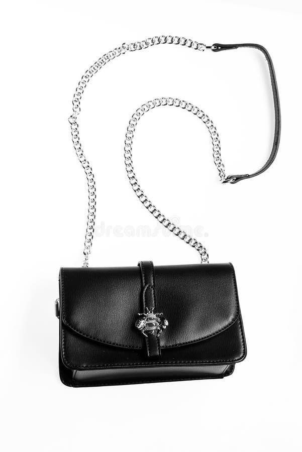 Modernes Zubehörkonzept Geldbeutel hergestellt aus schwarzem Leder heraus auf dem weißen Hintergrund, lokalisiert Handtasche für  lizenzfreies stockfoto